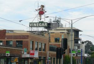 View of the Skipping Girl sign in Victoria streetscape